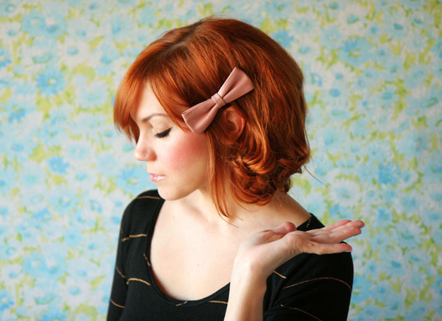 Style your hair with a sweet bow and curls.